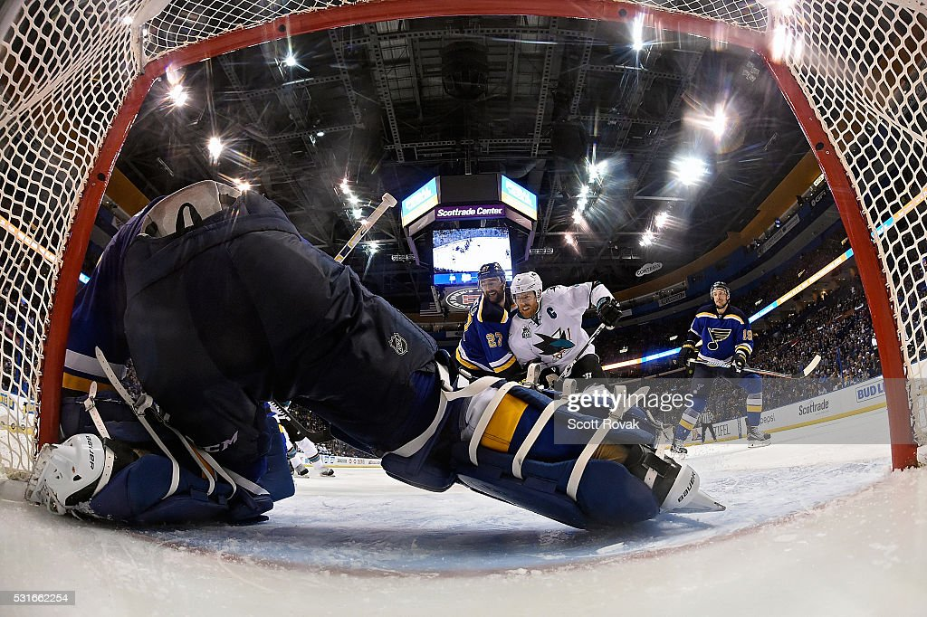 Alex Pietrangelo #27 of the St. Louis Blues defends against Joe Pavelski #8 of the San Jose Sharks as Brian Elliott #1 defends the net in Game One of the Western Conference Final during the 2016 NHL Stanley Cup Playoffs at the Scottrade Center on May 15, 2016 in St. Louis, Missouri.