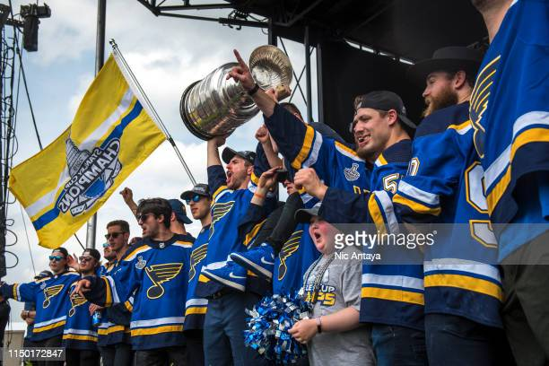 Alex Pietrangelo of the St. Louis Blues hoist the Stanley Cup while celebrating with his teammates during the St Louis Blues Victory Parade and Rally...