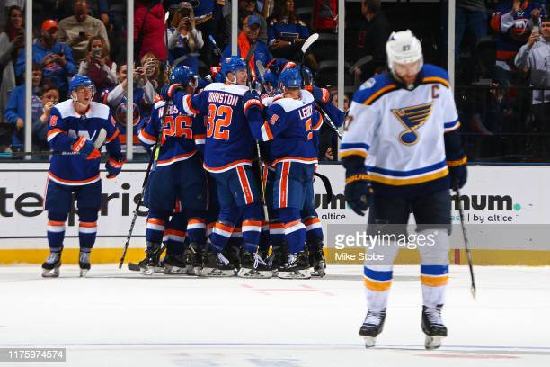 Alex Pietrangelo of the St. Louis Blues reacts as the New York Islanders celebrate their game-winning goal in overtime at NYCB Live's Nassau Coliseum...