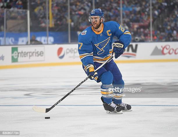 Alex Pietrangelo of the St Louis Blues skates with the puck against the Chicago Blackhawks during the 2017 Bridgestone NHL Winter Classic at Busch...