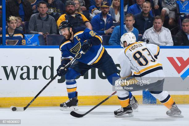 Alex Pietrangelo of the St Louis Blues takes a shot as Vernon Fiddler of the Nashville Predators defends in Game Two of the Western Conference Second...