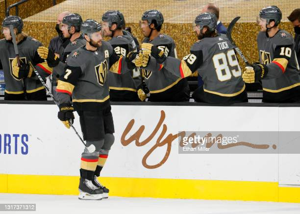 Alex Pietrangelo of the Vegas Golden Knights celebrates with teammates on the bench after scoring a first-period goal against the Colorado Avalanche...