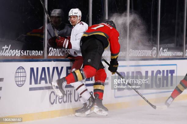 Alex Pietrangelo of the Vegas Golden Knights checks Joonas Donskoi of the Colorado Avalanche into the boards during the third period during the NHL...