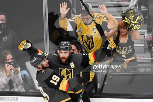 Alex Pietrangelo of the Vegas Golden Knights is congratulated by Reilly Smith after scoring a goal against the Montreal Canadiens during the third...