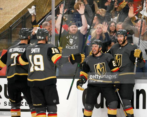 Alex Pietrangelo, Reilly Smith, Jonathan Marchessault and Nicolas Roy of the Vegas Golden Knights celebrate Marchessault's second-period power-play...
