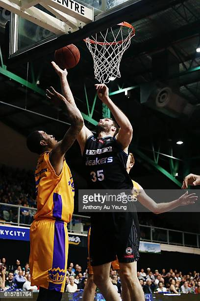 Alex Pledger of New Zealand goes up against Greg Whittington of Sydney during the round three NBL match between the New Zealand Breakers and the...