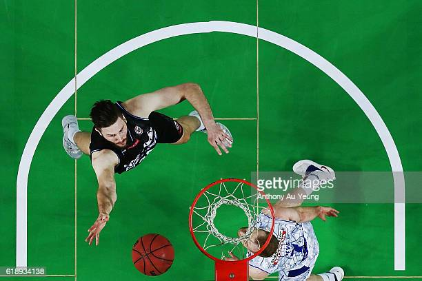 Alex Pledger of New Zealand puts up a shot against Brendan Trey of Adelaide during the round four NBL match between the New Zealand Breakers and the...