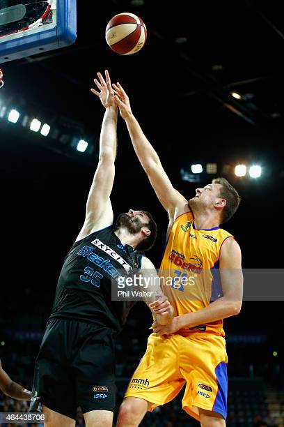 Alex Pledger of the Breakers and Daniel Johnson of Adelaide contest the ball during game one of the NBL Finals series between the New Zealand...