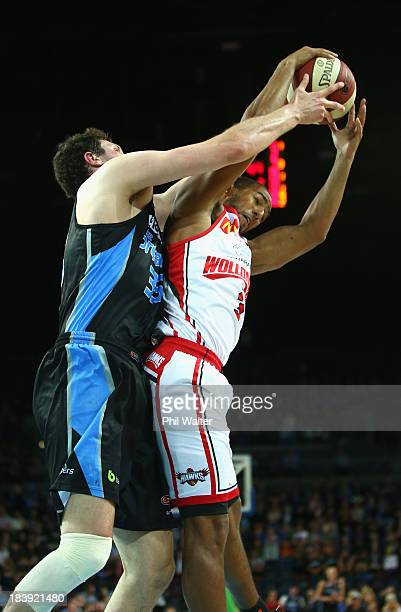 Alex Pledger of the Breakers and Dom Cooks of the Hawks contest the ball during the round one NBL match between the New Zealand Breakers and the...