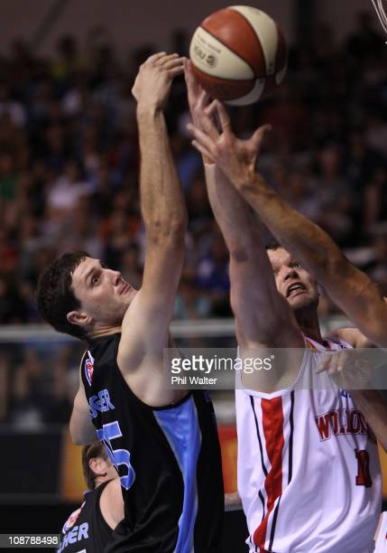 Alex Pledger of the Breakers and Larry Davidson of the Hawkes compete for the ball during the round 17 NBL match between the New Zealand Breakers and...