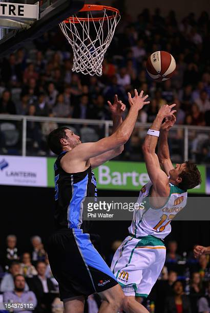 Alex Pledger of the Breakers and Peter Crawford of the Crocodiles compete for the ball during the round three NBL match between the New Zealand...