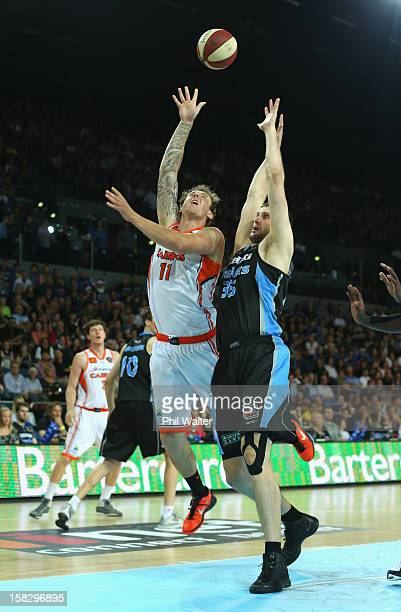 Alex Pledger of the Breakers attempts to block a shot from Cameron Tragardh of the Taipans during the round 11 NBL match between the New Zealand...
