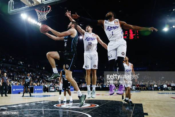 Alex Pledger of the Breakers goes for an upandunder reverse layup against Travis Leslie and Todd Blanchfield of the Kings during the round three NBL...
