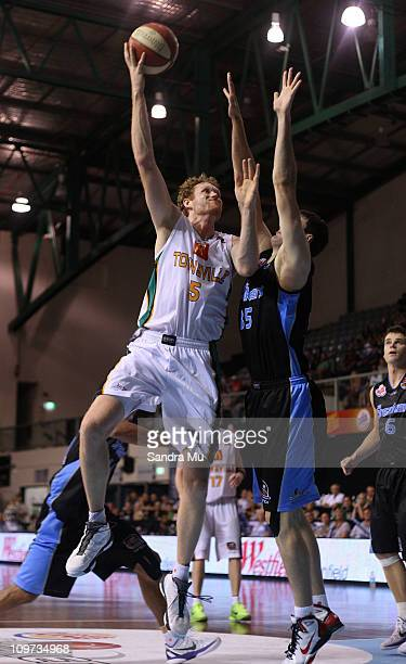 Alex Pledger of the Breakers holds his defence against Luke Schenscher of the Crocs during the round 21 NBL match between the New Zealand Breakers...