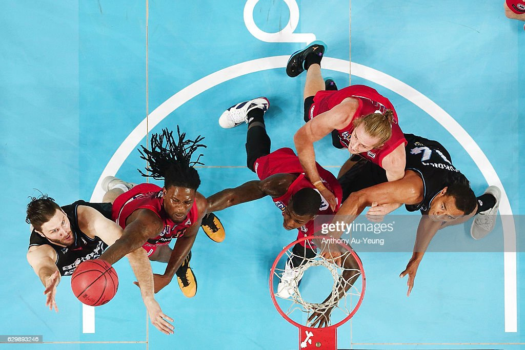 Alex Pledger of the Breakers puts up a shot against Jameel McKay of the Wildcats during the round 11 NBL match between New Zealand Breakers and Perth Wildcats at Vector Arena on December 15, 2016 in Auckland, New Zealand.