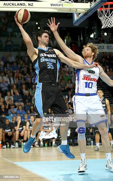 Alex Pledger of the Breakers tries to find support under pressure from Luke Schenscher of Adelaide during the NBL Rd 6 match between New Zealand and...