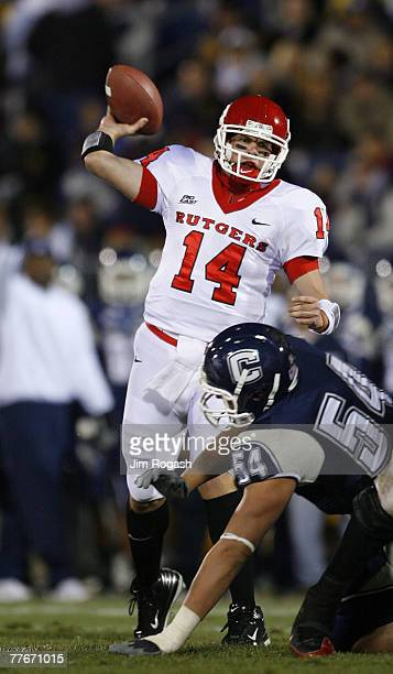 Alex Polito of the University of Connecticut Huskies presses quarterback Mike Teel of the Rutgers Scarlet Knights at Rentschler Field November 3,...