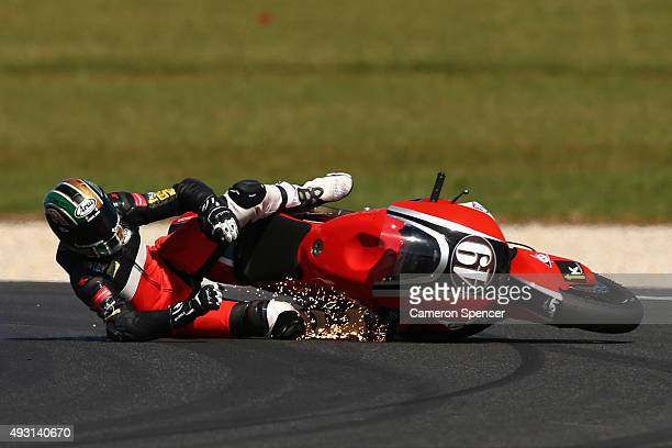 Alex Pons of Spain and the AGR team crashes during Moto2 warm up ahead of the 2015 MotoGP of Australia at Phillip Island Grand Prix Circuit on...