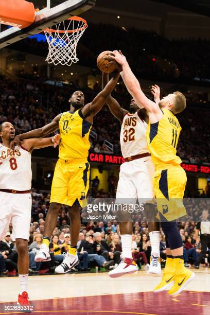 Alex Poythress and Domantas Sabonis of the Indiana Pacers fight Jeff Green of the Cleveland Cavaliers for a rebound during the first half at Quicken...