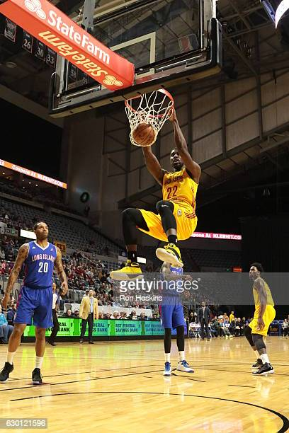 Alex Poythress of the Fort Wayne Mad Ants jams over Mike Scott of the Long Island Nets during their NBADL game at Memorial Coliseum on December 16...
