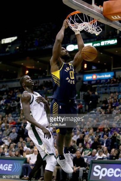 Alex Poythress of the Indiana Pacers dunks the ball past Thon Maker of the Milwaukee Bucks in the fourth quarter at the Bradley Center on January 3...