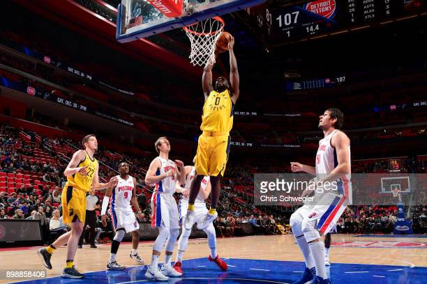 Alex Poythress of the Indiana Pacers goes up for a dunk against the Detroit Pistons on December 26 2017 at Little Caesars Arena in Detroit Michigan...