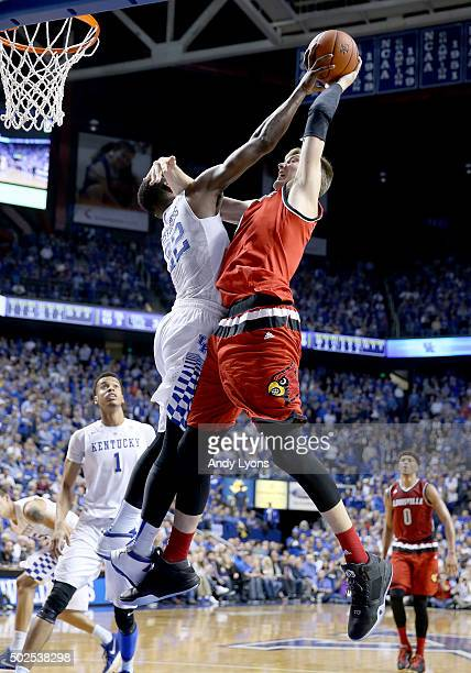 Alex Poythress of the Kentucky Wildcats blocks the shot of Matz Stockman of the Louisville Cardinals during the game at Rupp Arena on December 26...