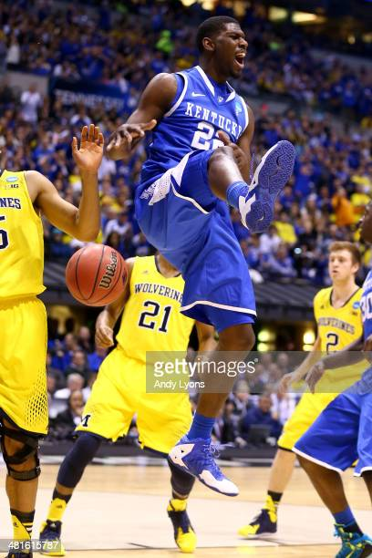 Alex Poythress of the Kentucky Wildcats celebrates after dunking the ball over Caris LeVert of the Michigan Wolverines in the first half during the...