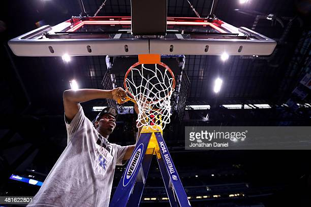 Alex Poythress of the Kentucky Wildcats cuts the net after defeating the Michigan Wolverines 75 to 72 in the midwest regional final of the 2014 NCAA...