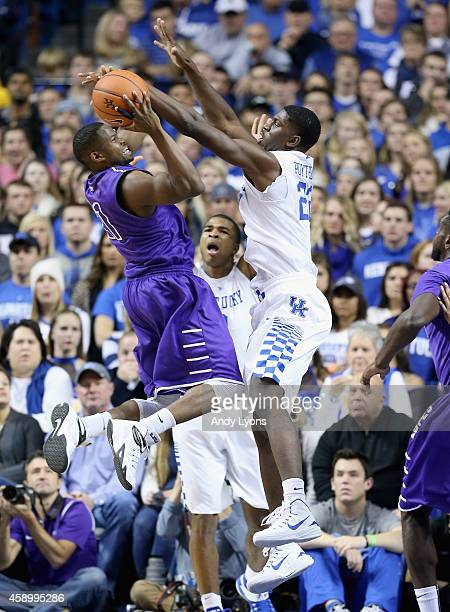 Alex Poythress of the Kentucky Wildcats defends the shot of Jerome Garrison of the Grand Canyon Antelopes at Rupp Arena on November 14 2014 in...