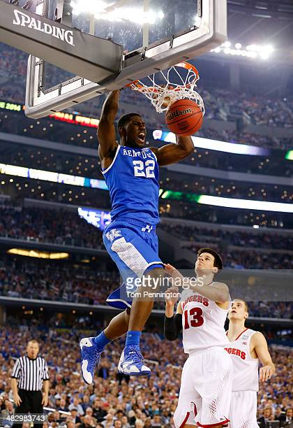 Alex Poythress of the Kentucky Wildcats dunks as Duje Dukan of the Wisconsin Badgers defends during the NCAA Men's Final Four Semifinal at ATT...