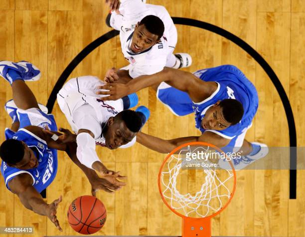 Alex Poythress of the Kentucky Wildcats goes up for a basket against Amida Brimah of the Connecticut Huskies during the NCAA Men's Final Four...
