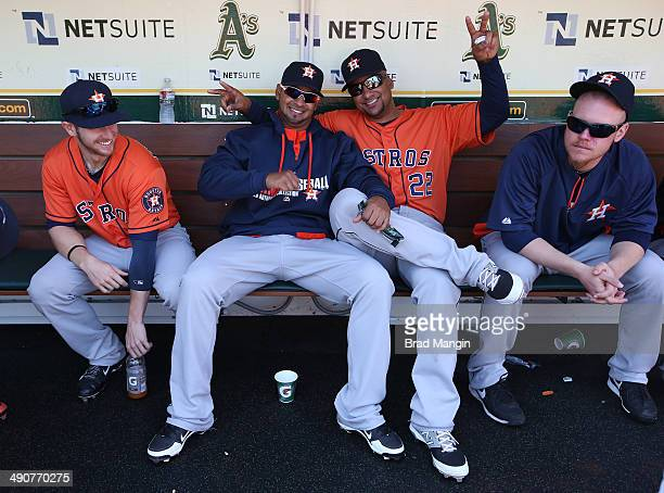 Alex Presley Jesus Guzman Carlos Corporan and Brett Oberholtzer of the Houston Astros get ready in the dugout before the game against the Oakland...