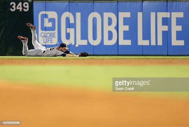 Alex Presley of the Houston Astros dives for a ball during a game against the Texas Rangers at Globe Life Park in Arlington on September 23 2014 in...