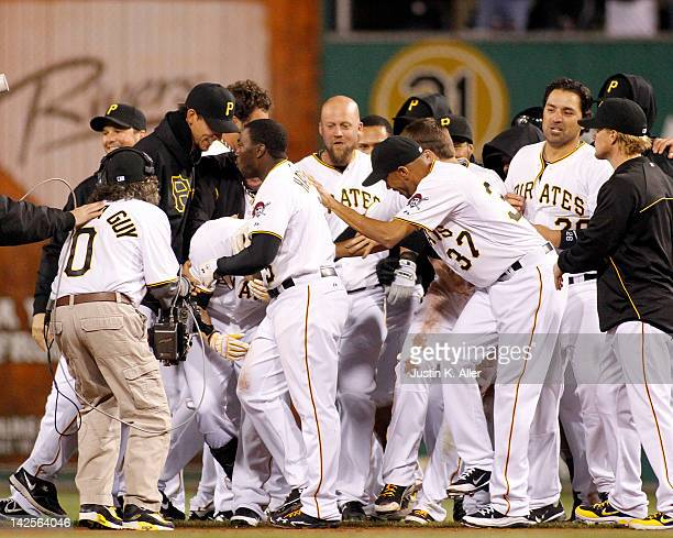 Alex Presley of the Pittsburgh Pirates is mobbed after driving in the winning run against the Philadelphia Phillies during the game on April 7 2012...