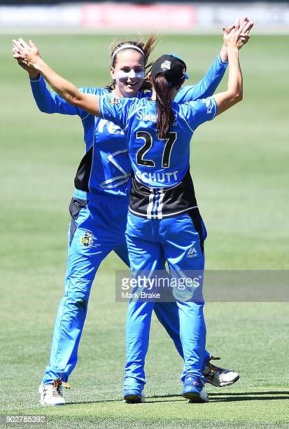 Alex Price and Megan Schutt of the Adelaide Strikers celebrates after taking the wicket of Erin Osborne of the Melbourne Stars during the Women's Big...