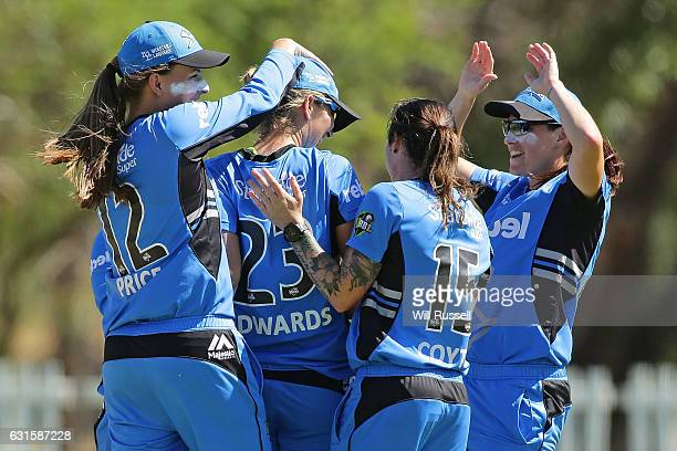 Alex Price of the Strikers celebrates after taking a catch off Jess Cameron of the Stars during the Women's Big Bash League match between the...