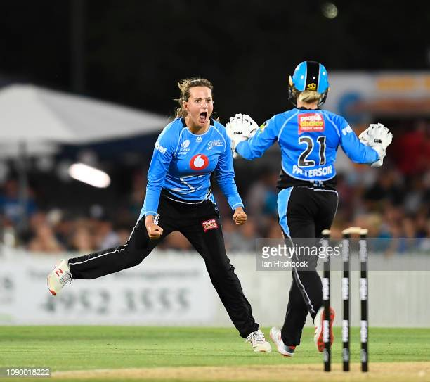 Alex Price of the Strikers celebrates the wicket of Jess Jonassen of the Heat during the Womens Big Bash League match between the Brisbane Heat and...