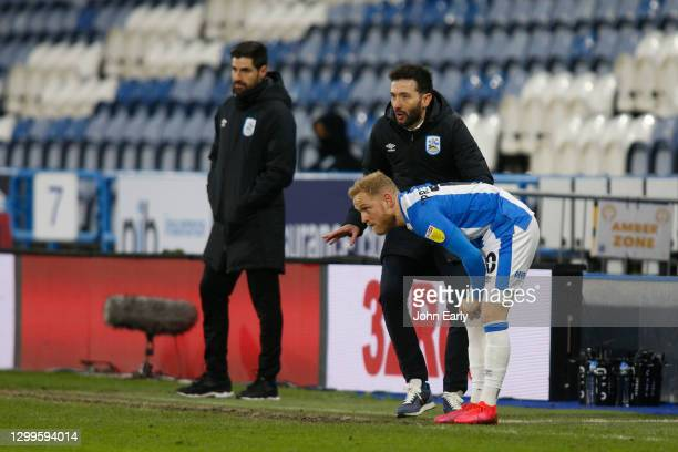 Alex Pritchard and Carlos Coberán the Head Coach of Huddersfield Town during the Sky Bet Championship match between Huddersfield Town and Stoke City...