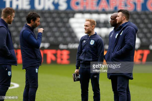 Alex Pritchard and Danny Cowley the manager of Huddersfield Town during the Sky Bet Championship match between Swansea City and Huddersfield Town at...