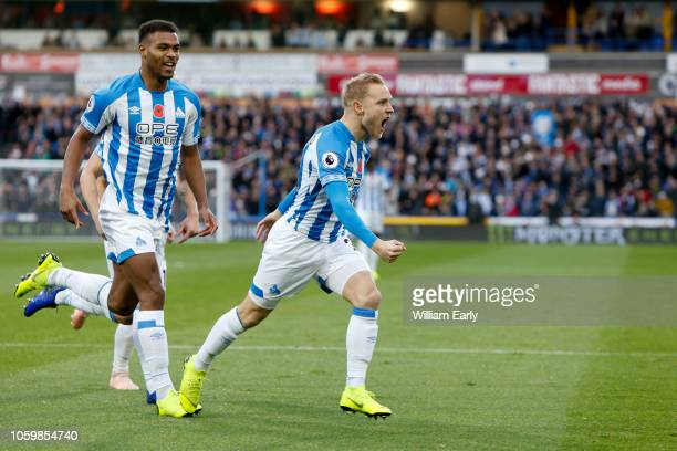 Alex Pritchard and Steve Mounié of Huddersfield Town celebrate during the Premier League match between Huddersfield Town and West Ham United at John...