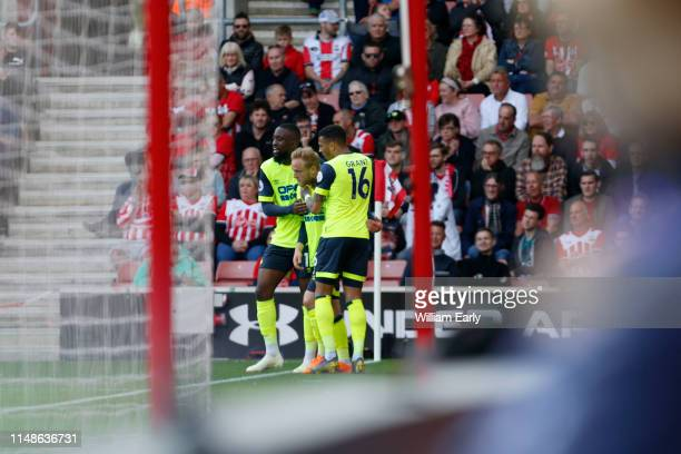 Alex Pritchard Isaac Mbenza and Karlan Grant of Huddersfield Town celebrate during the Premier League match between Southampton FC and Huddersfield...