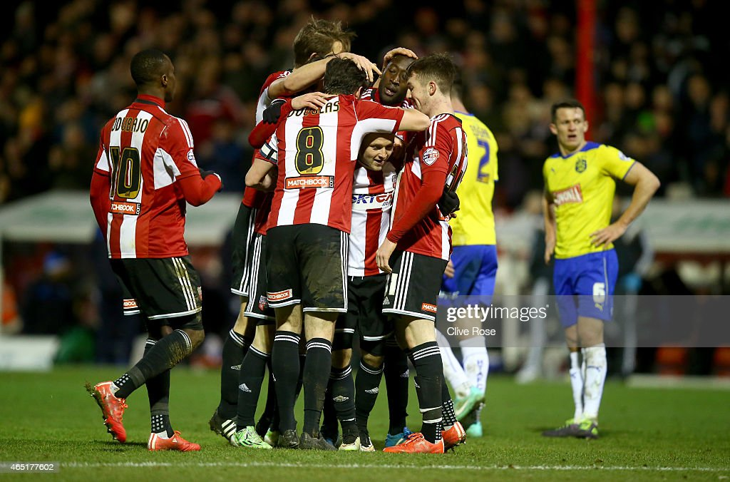 Alex Pritchard of Brentford celebrates his goall during the Sky Bet Championship match between Brentford and Huddersfield Town at Griffin Park on March 3, 2015 in Brentford, England.