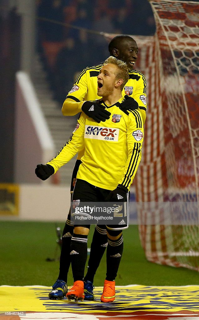Alex Pritchard of Brentford celebrates scoring the third goal from the penalty spot during the Sky Bet Championship match between Nottingham Forest and Brentford at the City Ground on November 5, 2014 in Nottingham, England.