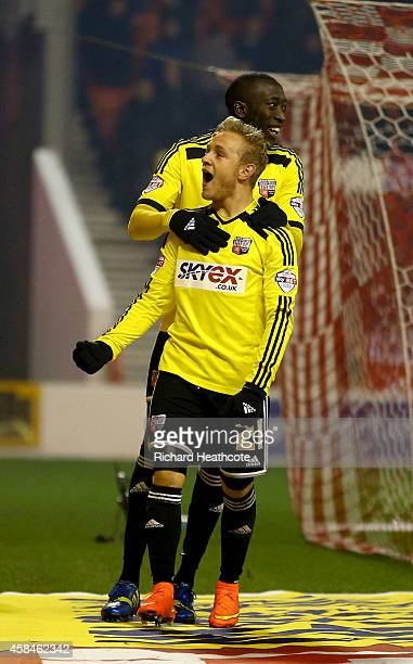 Alex Pritchard of Brentford celebrates scoring the third goal from the penalty spot during the Sky Bet Championship match between Nottingham Forest...