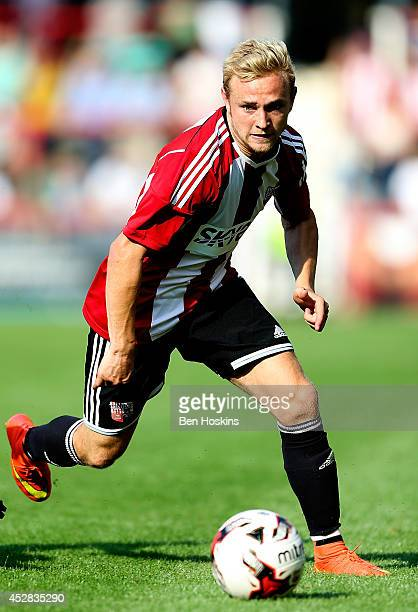 Alex Pritchard of Brentford in action during the Pre Season Friendly between Brentford and Nice at Griffin Park on July 26 2014 in Brentford England