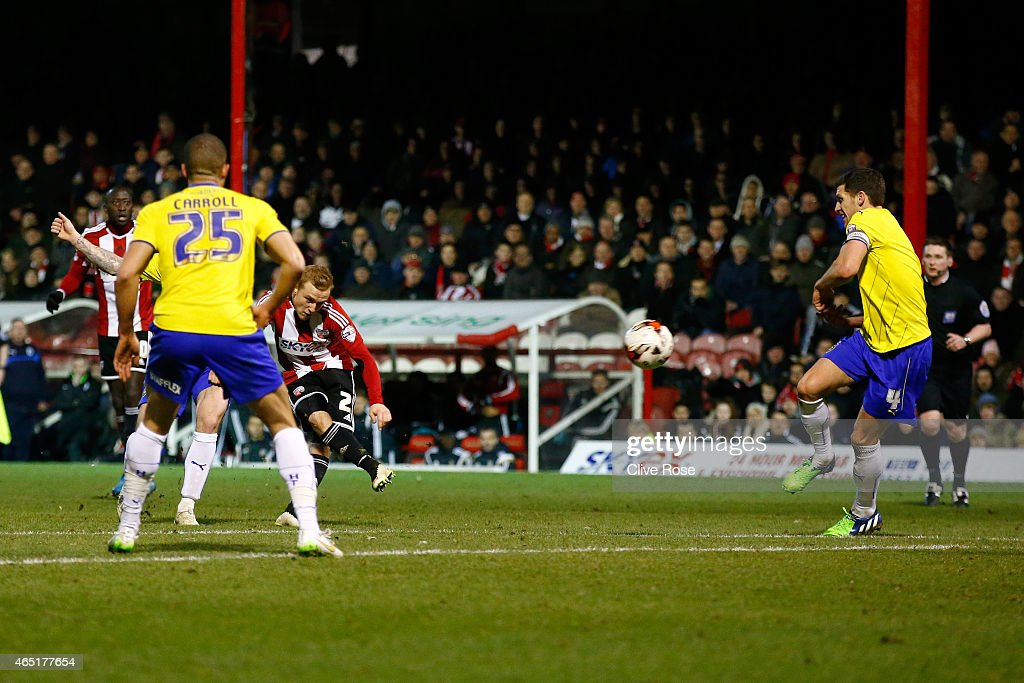 Alex Pritchard of Brentford scores a goal during the Sky Bet Championship match between Brentford and Huddersfield Town at Griffin Park on March 3, 2015 in Brentford, England.