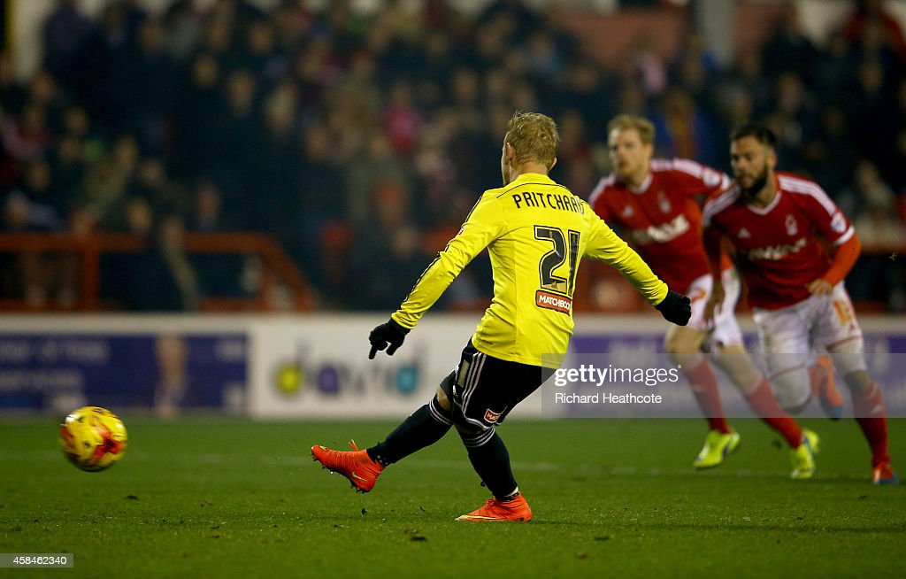 Alex Pritchard of Brentford scores the third goal from the penalty spot during the Sky Bet Championship match between Nottingham Forest and Brentford at the City Ground on November 5, 2014 in Nottingham, England.