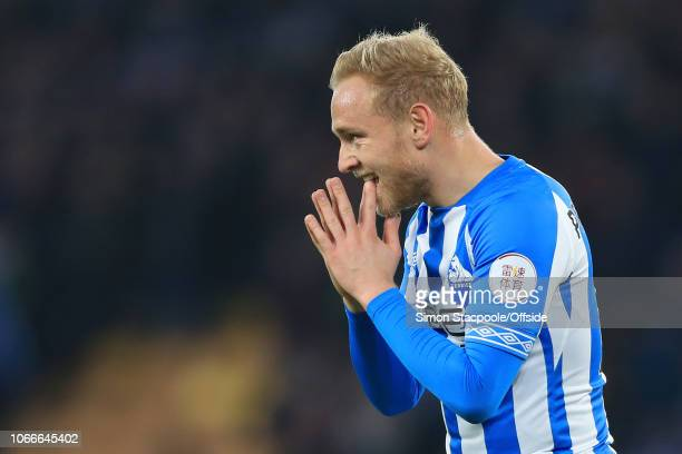 Alex Pritchard of Huddersfield looks dejected during the Premier League match between Wolverhampton Wanderers and Huddersfield Town at Molineux on...
