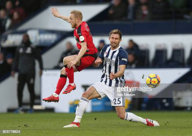 Alex Pritchard of Huddersfield Town and Craig Dawson of West Bromwich Albion battle for possession during the Premier League match between West...